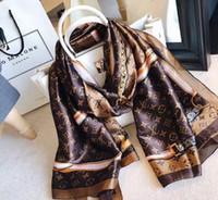 bufandas al por mayor-Primavera bufanda de seda 2019 mujeres calientes carta bufanda del mantón de moda cuello largo anillo regalo de Navidad al por mayor 180x90 cm