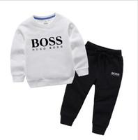 butik tutu toptan satış-2019 Sıcak Bebek erkek kıyafetler toddler mektubu üst + dinozor baskılı pantolon 2 adet set 2019 yaz moda butik çocuk Giyim C5937 Setleri