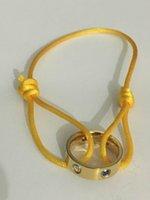 pulseras brazalete de oro amarillo al por mayor-Anillo de acero inoxidable 2019 de alta calidad con un brazalete de cuerda amarilla con brazalete de diamante azul para los regalos de los amantes con caja y estuche