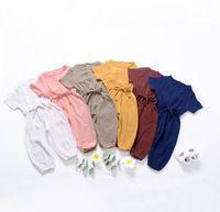 mamelucos de otoño al por mayor-INS recién llegados caen bebé Niña trepando mameluco 100% algodón cuello redondo Manga corta Color sólido Mameluco de la niña 0-2T