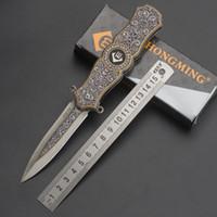 hilandero plegable al por mayor-Fidget Spinner 2 en 1 cuchillos plegables Juguetes creativos Mango de aluminio Cuchillo de bolsillo Autodefensa Herramientas al aire libre para regalos Cuchillos para acampar