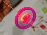 rad fliegendes spielzeug großhandel-Flying Magic Lighting Kinderspielzeug Flash-Zugleine Wind Feuerrad leuchtende Schwungrad Pfeife Weihnachten Kindergeschenk Neuheit Flying Toys