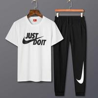 интернет черный оптовых-Новый костюм для беговых брюк продается в интернете в черно-белых тонах. Брюки длинные и имеют хорошую воздухопроницаемость