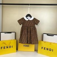 faldas esponjosas moradas al por mayor-Vestido de verano para bebé niña ropa de solapa impresión de manga corta vestido niños ropa casual moda vestidos niños ropa niñas QA-5