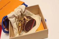bolsos de marca china al por mayor-Nuevos encantos de la marca llavero bolsa moda llavero colgante creativo bolsa de cuero llavero regalo mujeres de lujo diseñador llavero