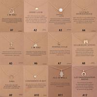 mulheres cruzam colares venda por atacado-Chegada Nova Colar Dogeared Com Zodiac Key cartão de presente do elefante pérola amor Asas Cruz assinar Compass pingente de lótus Para as mulheres moda jóias