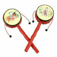 el davulları toptan satış-Bebek Çocuk Karikatür El Bell Oyuncaklar Ahşap Çıngırak Davul Müzik Aletleri Geleneksel Çıngırak Davul Spin Oyuncak için Çin Geleneği