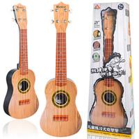 21 zoll ukulele gitarre groihandel-Kinder Studie Kunststoff Gitarre Bunte Schöne Ukulele Anfänger Musikinstrumente Spielzeug Tuba 21 Zoll Batterie Erforderlich Heißer Verkauf 32blb1