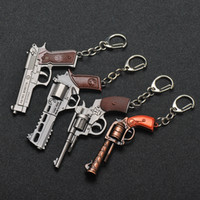 Wholesale keyring guns for sale - Group buy New D Gun Keychain Revolver Model Pistol Pendant Key Chain Men s Keyring Revolver eat chicken game Men Women keychain
