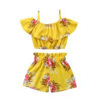 terno amarelo para criança venda por atacado-Crianças roupas para meninas shorts de flores e fora do ombro babados top terno de verão crianças roupas amarelas 100% algodão define bebê conjunto criança