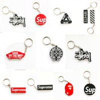 Wholesale car branded cell phones online – Sup Keychain Cell Phone Straps Car Charm Tide Brand Creative Personality Car Charms Wallet Bags Key Chain Hanging Hand Strap