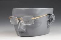 gözlük erkek toptan satış-2019 Vintage Çerçevesiz Güneş Gözlüğü Marka Tasarımcı Güneş Gözlüğü Erkekler Kadınlar Için Metal Alaşım Çerçeve Ayna Şeffaf Lens Kadın Erkek Gözlük Için