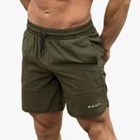 xxl pantalones de playa para hombre al por mayor-Ejecución de verano Pantalones Pantalones cortos Hombres Deportes Correr pantalón corto deportivo Sport BEACHing calzoncillos trajes de baño para hombre gimnasio de Crossfit cortos