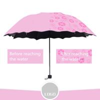 mudanças de logotipo venda por atacado-OEM china fábrica Publicidade guarda-chuva logotipo personalizado rega cor floração mudando de guarda-chuva três dobrável guarda-chuva protetor solar de plástico preto