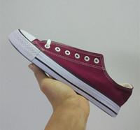 precio de zapatos de lona blanca al por mayor-¡Nuevo precio promocional de fábrica! Zapatos de lona de calidad para mujeres y hombres Zapatos de lona clásicos bajos, blancos y altos Zapatos de lona ocasionales