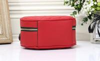 bolsas de viaje usadas al por mayor-Bolso cosmético del bolso de maquillaje del bolso de embrague lindo caliente del bowknot para el uso del organizador y del artículo de tocador del maquillaje del viaje