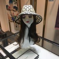 sombrero de paja para mujer de moda al por mayor-2019 lujos diseñador sombrero de copa tapas de paja para mujer de moda cappelli firmati principios de primavera y verano nuevo sombrero de sol de alta calidad G-004
