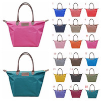Wholesale folding shopping bag polyester online - 18 Colors Dumpling Handbag Women Candy Color Folding Cosmetic Bags Waterproof Storage Bag Zipper Simple Totes Shopping Bags CCA10876