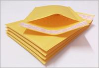 papierblasen-umschlag großhandel-100 teile / los Luftblasenversender Gepolsterte Umschläge Verpackung Gelbe Kraftpapiere 110 * 130mm Versandtaschen Kraftluftblasenversender Umschlagbeutel