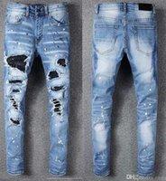 leichte löcher großhandel-Ami Europe America High Street Trend Loch Lokomotive Jeans hellblau alten schlanken Punk Jugend Füße Hosen Amiri Jeans Jean