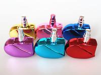 frascos de perfume 25ml al por mayor-Botellas de perfume calientes de vidrio en forma de corazón de 25 ml con atomizador recargable atomizador de perfume vacío para mujeres 6COLORES