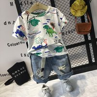 Wholesale dinosaur baby clothing print for sale - Group buy 2PCS boys fashion clothing set kids dinosaur printed short sleeve t shirt and holes short set baby casual clothes children T T200414