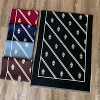 nuevas hermosas bufandas al por mayor-Diseñador nuevo otoño e invierno bufanda bufanda de cachemira para hombres y mujeres de alta calidad moda hermosa bufanda versátil chal 180 * 70cm 5 colores