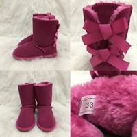 botones para zapatos al por mayor-Niñas Australia Estilo Niños Botas de nieve Botón lindo Impermeable Slip-on Niños Botas de cuero de vaca de invierno zapatos de diseñador de lujo Marca EUR 21-35