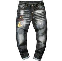 nuevos jeans amarillos para hombre al por mayor-Tendencia Nuevo bordado Mariposa amarilla Pintura en aerosol Wave Point Slim Jeans ajustados rectos para hombres Pantalones con agujeros