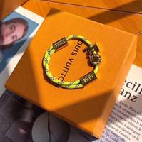 ingrosso braccialetti per fascino femminile-Corda in nylon fatto a mano da donna e uomo con fibbia in oro Bracciale in acciaio inossidabile titanio con charm in corda arancione e gialla spedizione gratuita