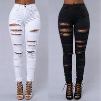 pantalon blanco negro al por mayor-Nuevos calzados de verano para mujeres con pantalones vaqueros de diseño en Europa y América Pantalones elásticos finos con orificios delgados en blanco y negro