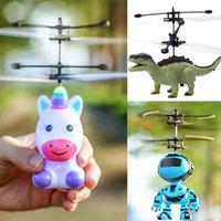 ingrosso sensori del robot-RC giocattolo di volo LED luminoso elicottero Unicorn dinosauro robot elettrico del sensore velivoli di telecomando fumetto gioca per il regalo dei capretti E1304