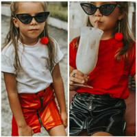 jupes design de mode achat en gros de-Filles mode détail en cuir Zipper Jupes enfants design de luxe classique jupe plissée rouge noir jupes courtes enfants boutique de vêtements