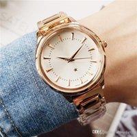d markenuhren großhandel-Luxus-Designer-Damenuhren der Top-Modemarke Omeg 14 Farben 34mm Damen-Kleiduhren Edelstahlarmband Schweizer Uhr orologio d