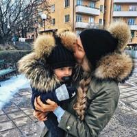 sombreros del bebé del cubo para las muchachas al por mayor-Padres e hijos niños sombreros de invierno bebé Mama sólidos Pom Pom Beanie cubo diseño de lujo Caps hacen punto del bebé muchachas de los sombreros casquillo de los niños del sombrero