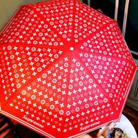 tela paraguas lluvia al por mayor-Paraguas rojo de la boda S + L letra de la mezcla de la marca de impresión rojo plegable automático Parasol Jubilant Color nuevos paraguas