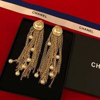 pendientes del club nocturno al por mayor-Venta caliente borla de oro y diseño de perlas para mujeres night club pendiente de gota Envío gratis PS6785A
