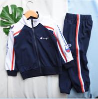 niño de terciopelo al por mayor-Diseñador Champion Kids marca de ropa con las muchachas de los juegos de la ropa de los niños arropa sistemas pantalones chaqueta de terciopelo otoño Cuatro nudos chándales 92120