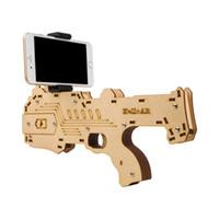 tahta tabanca oyuncakları toptan satış-SICAK! Bluetooth AR-Gun Yeni stil 3D VR Oyunları Ahşap Malzeme Oyuncak Taşınabilir AR Oyun-Gun Android iOS iPhone Telefonlar için