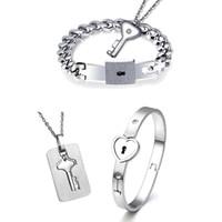 bilezik severler anahtar kilidi toptan satış-Titanyum Bulmaca Çift Kalp Kilit Anahtar Çift Bilezik Kolye Lover Takı Seti
