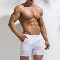 iluminación de haz grande al por mayor-Pantalones cortos deportivos de playa para hombres Cintura elástica Cintura con haz de línea Pantalones finos y ligeros de playa de secado rápido Big Pocket Surf 2019
