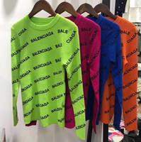 diseño damas jersey al por mayor-2019 otoño invierno de las mujeres suéteres con capucha de las señoras de tejer tops de manga larga Tamaño libre Carta jacquard diseño de la tapa del suéter Marca