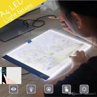 comprimés jouets achat en gros de-Tablette à dessin à LED dimmable tablette graphique écriture peinture boîte à lumière calque conseil de copie tampons numérique Artcraft A4 tableau de copie LED Conseil jouet