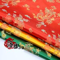 rote chinesische kleidung großhandel-Red Brocade Jacquard Tuch Kostüm chinesische Hochzeit COS Kleidung Cheongsam Damast Satin Stoff Dragon Phoenix