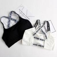 colete esportivo branco venda por atacado-Mulheres esporte sutiãs carta de fitness halved cinto colete top push up mulheres preto branco correndo yoga ginásio sutiãs esportivos
