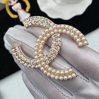 ingrosso perni di corallo perla-Spille Hot perla di cristallo del Rhinestone Oro Argento Spilla perno cavo Corpetto Spilla i monili delle donne 001