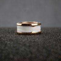 anillo de oro blanco día de san valentín al por mayor-Alta versión para mujer Blanco Negro Cerámica Anillos Mujer Encantos Espiral 14 k Anillo de oro Día de San Valentín Joyería fina en venta
