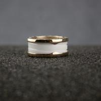 ingrosso anello di giorno del biglietto di s. valentino dell'oro bianco-Alta versione Donna Bianco Nero Ceramica Anelli Donna Charms Spiral Oro 14k Anello San Valentino Fine Jewelry in vendita