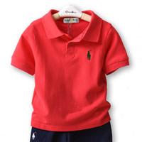polo de algodón para niños al por mayor-2019 niños del verano ropa de diseñador niños niños solapa manga corta polo camiseta muchachos camisetas marca bebé niña ropa niñas tops de algodón clásico