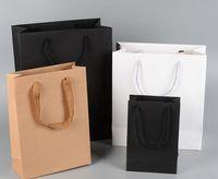 boda de papel marrón al por mayor-10 tamaños en stock y bolsa de regalo de papel personalizada marrón blanco negro favorece la boda bolsa de papel kraft con asas al por mayor